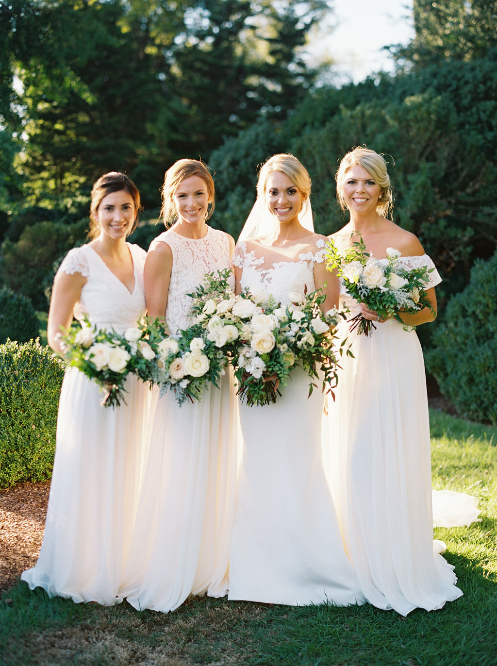 kristinsweeting_3RG_familyparty-0113.jpgAll white bridesmaid dresses with white flowers and greenery. Nashville Wedding Floral Design.