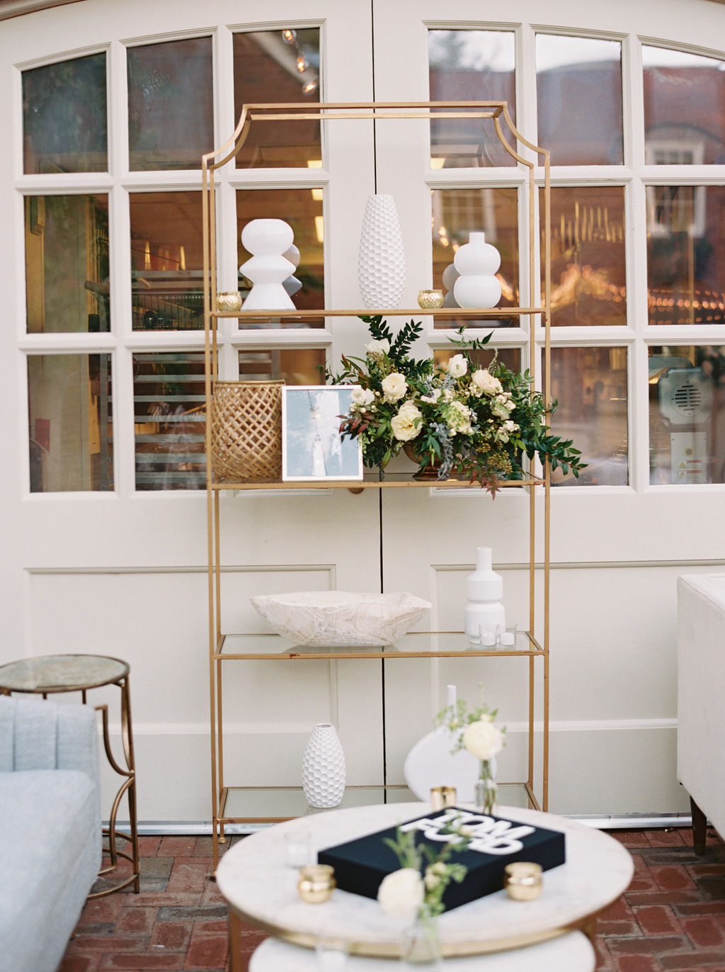 Low centerpiece with white and blush garden roses and ranunculus with natural greenery. Southeastern Wedding Floral Design