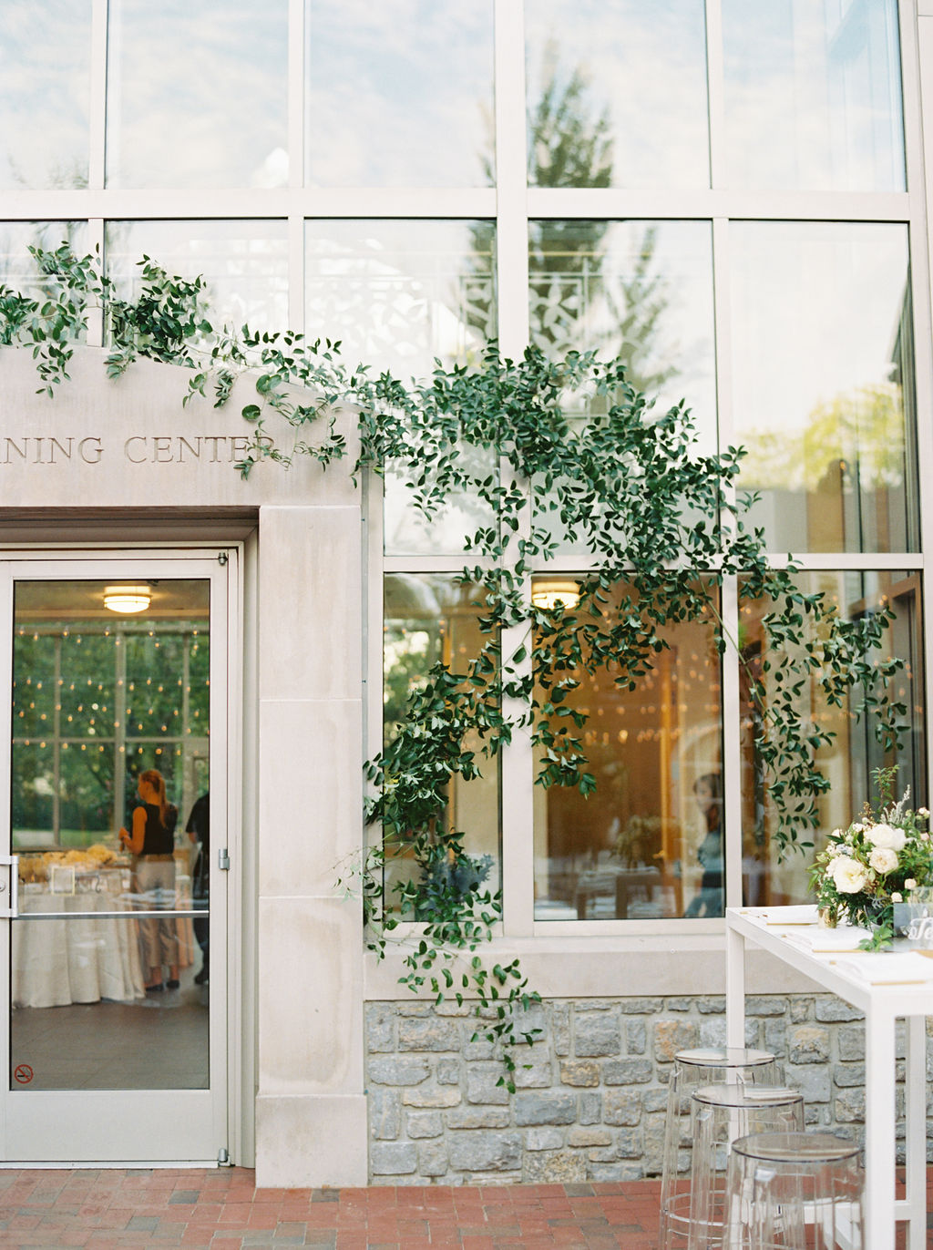Lush, vine-like greenery growing on the window of the Frist Learning Center. Nashville Wedding Floral Design
