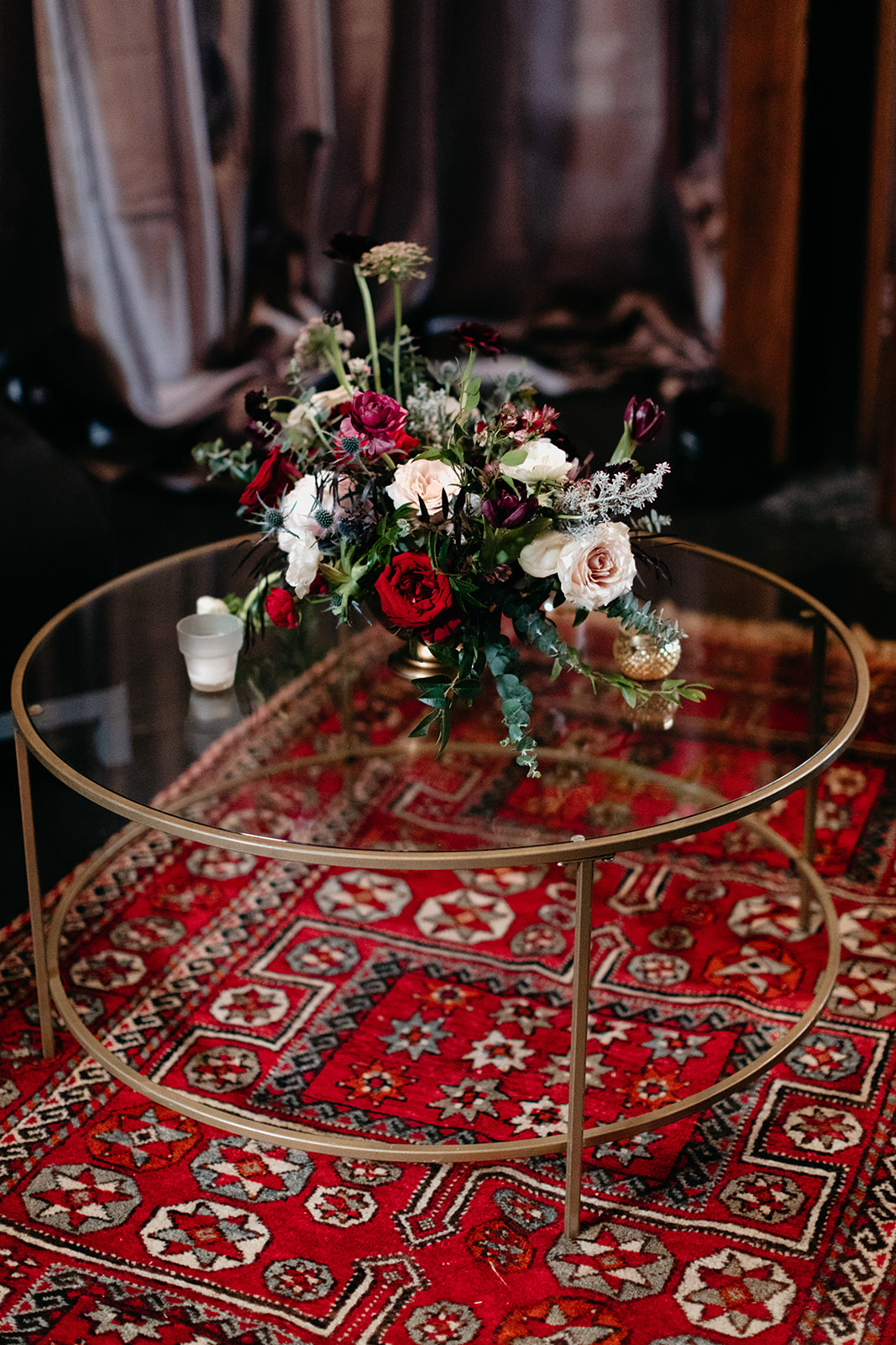 Moody, modern warehouse wedding in Nashville with Persian rugs and and lush floral design.