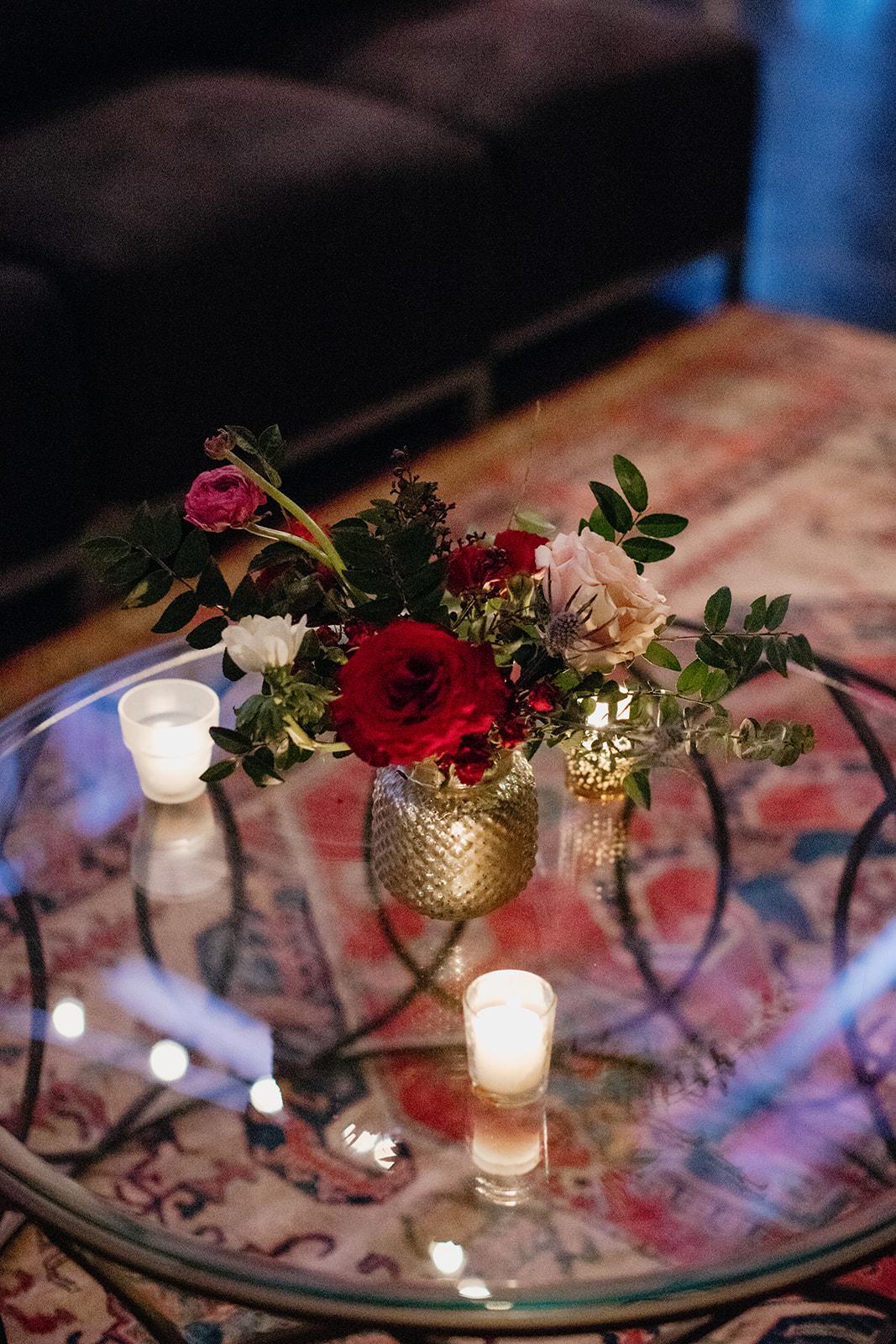 Gold mercury glass centerpieces with marsala garden roses and ranunculus. Nashville Wedding Floral Designer.