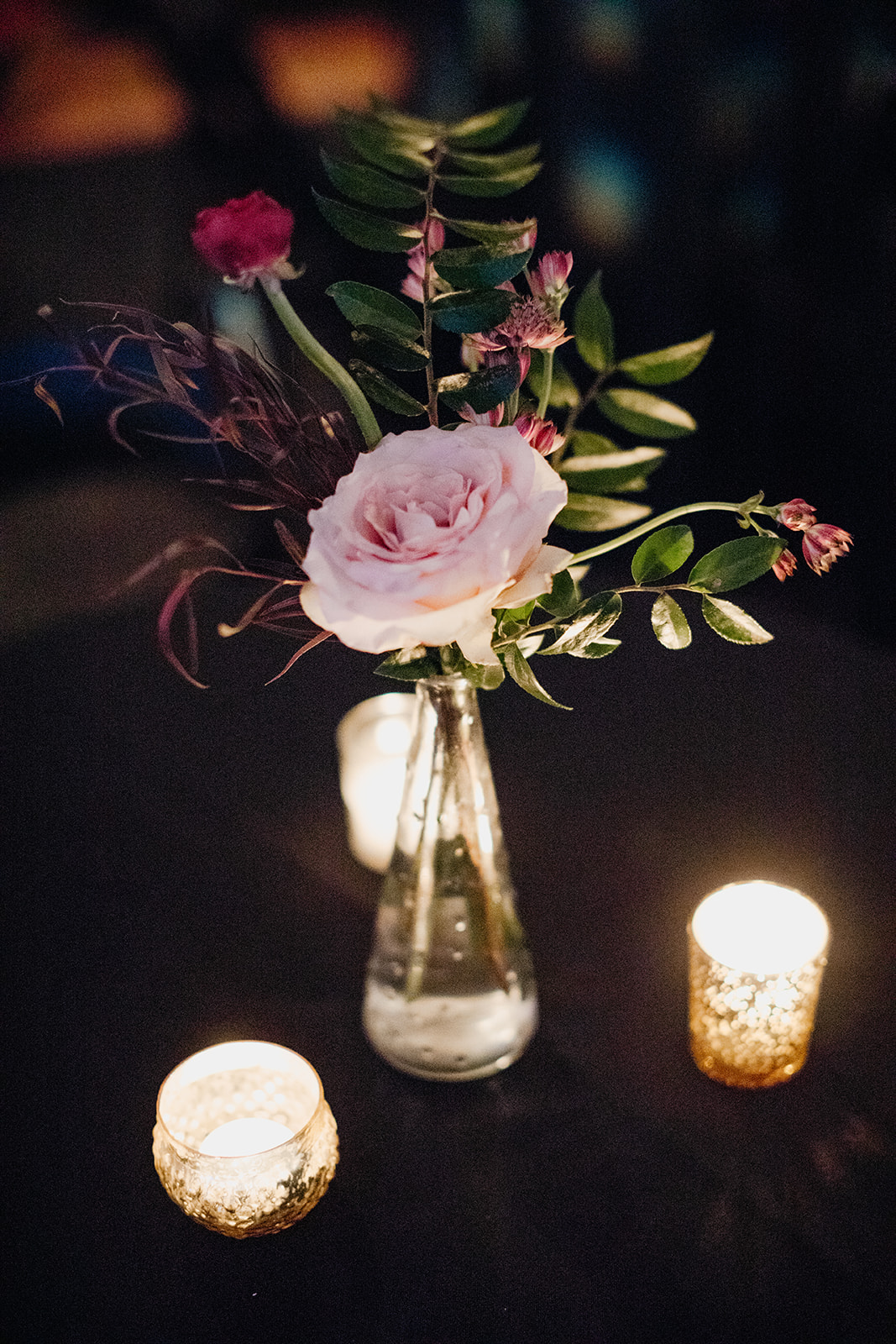 Candlelit wedding reception with marsala and burgundy florals. Real January Wedding at Marathon Music Works in Nashville, TN!