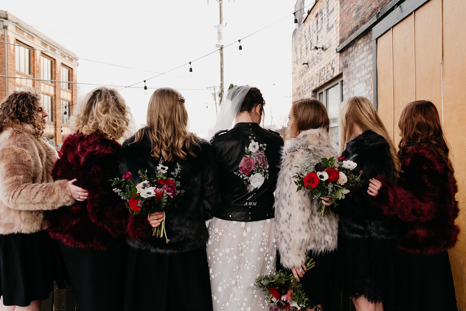 Fur coats and a custom leather jacket. Badass, edgy bridesmaid style, Nashville Wedding Florist.