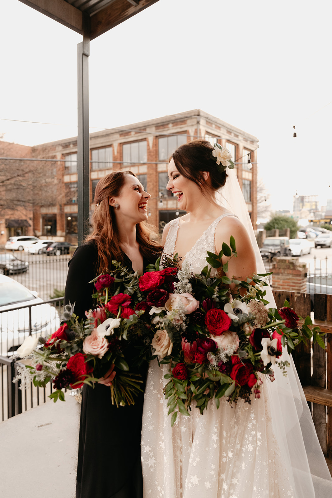 Black bridesmaid dresses with jewel tone and greenery bouquets in a natural, garden-inspired floral style. Nashville Wedding Florist.