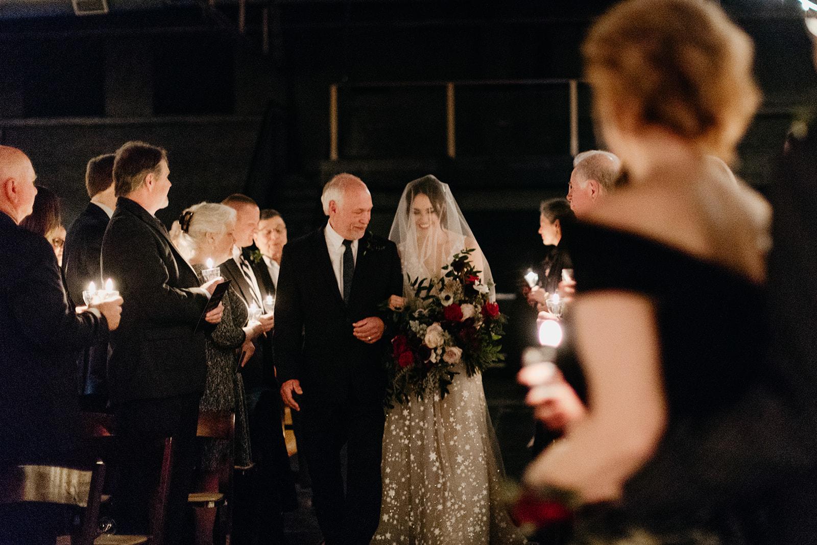 Candlelit entrance for the bride! Nashville Wedding flowers at Marathon Music Works.