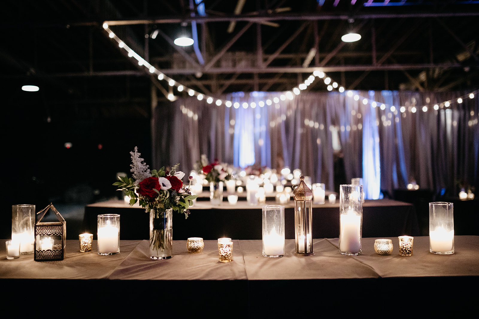 Candlelit wedding reception with marsala and burgundy florals. Real January Wedding at Marathon Music Works!