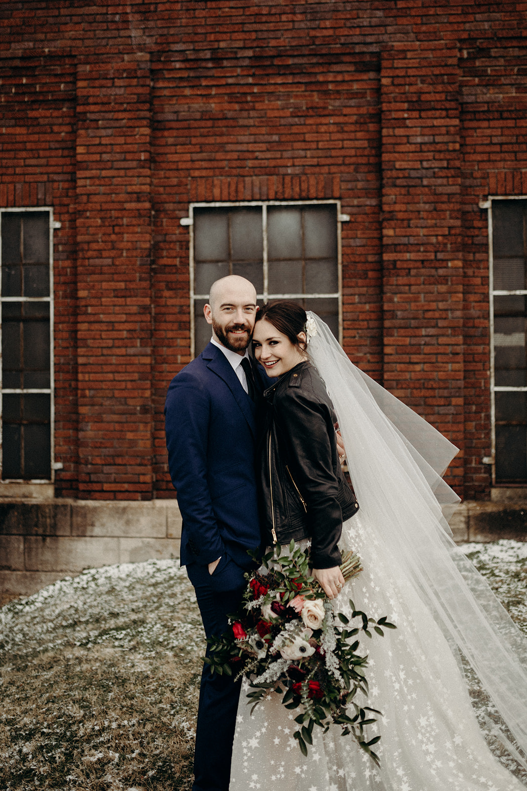 Next morning bride and groom photos! Lush bridal bouquet with peonies, garden roses, and anemones. Nashville, TN luxury wedding floral design with the bride in a leather jacket!!