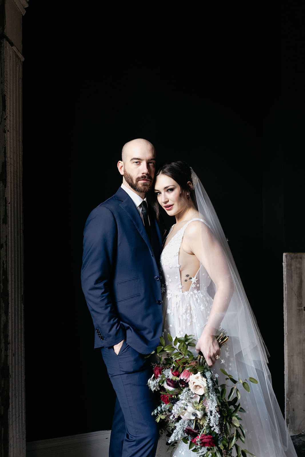 Starry night inspired wedding! Jewel tone bride's bouquet and star covered wedding dress.