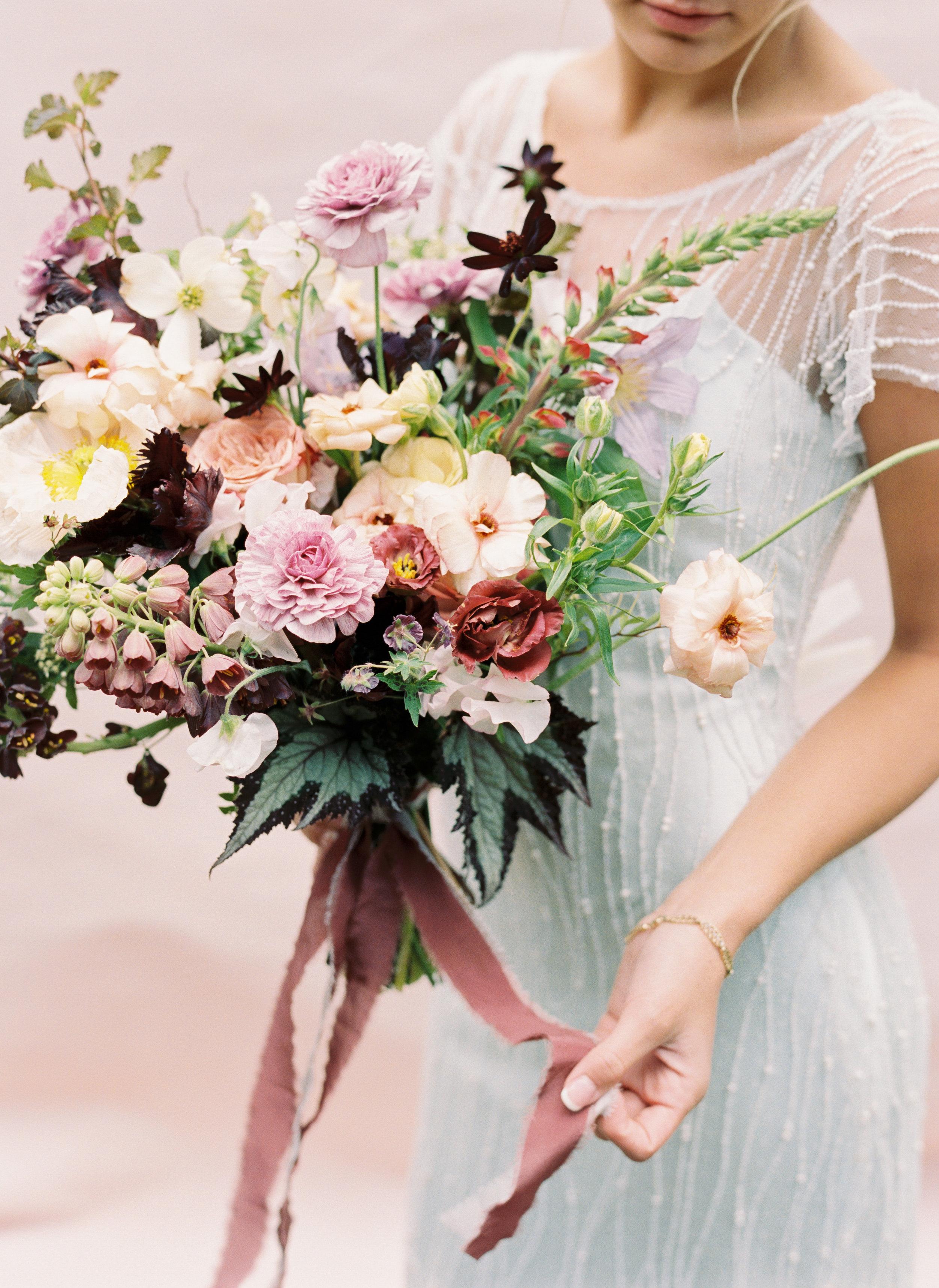 Pale blue wedding dress with lush, organic bridal bouquet. Nashville Wedding Florist.