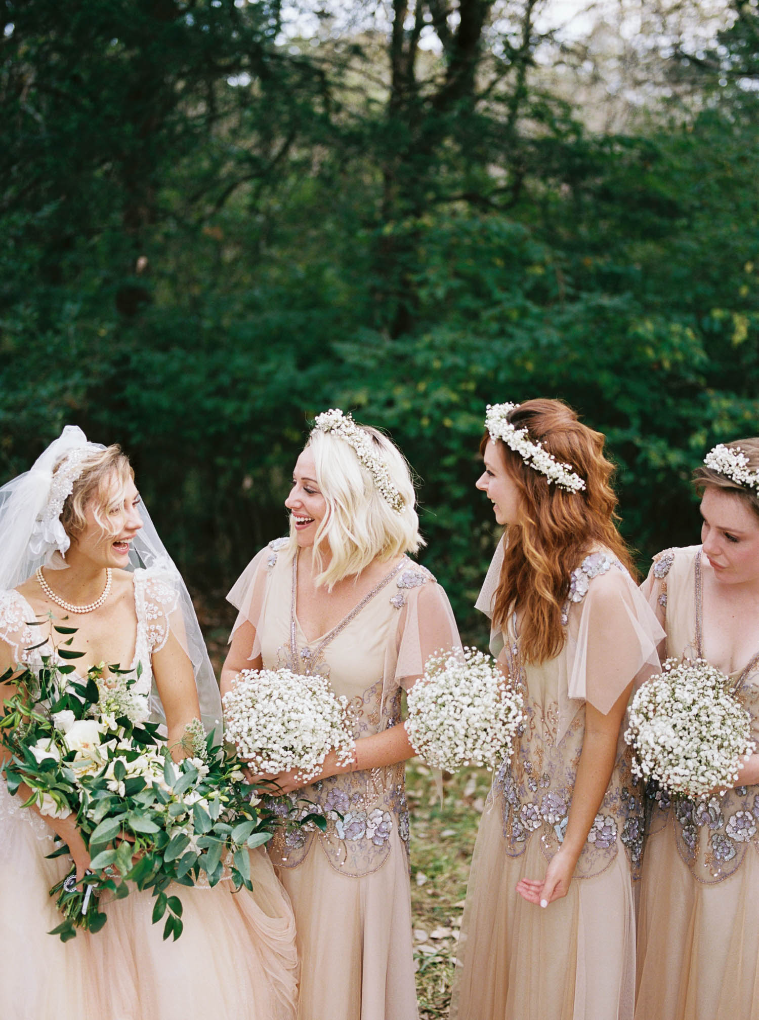 Bohemian bridesmaid style with flower crowns. Nashville Wedding Florist.