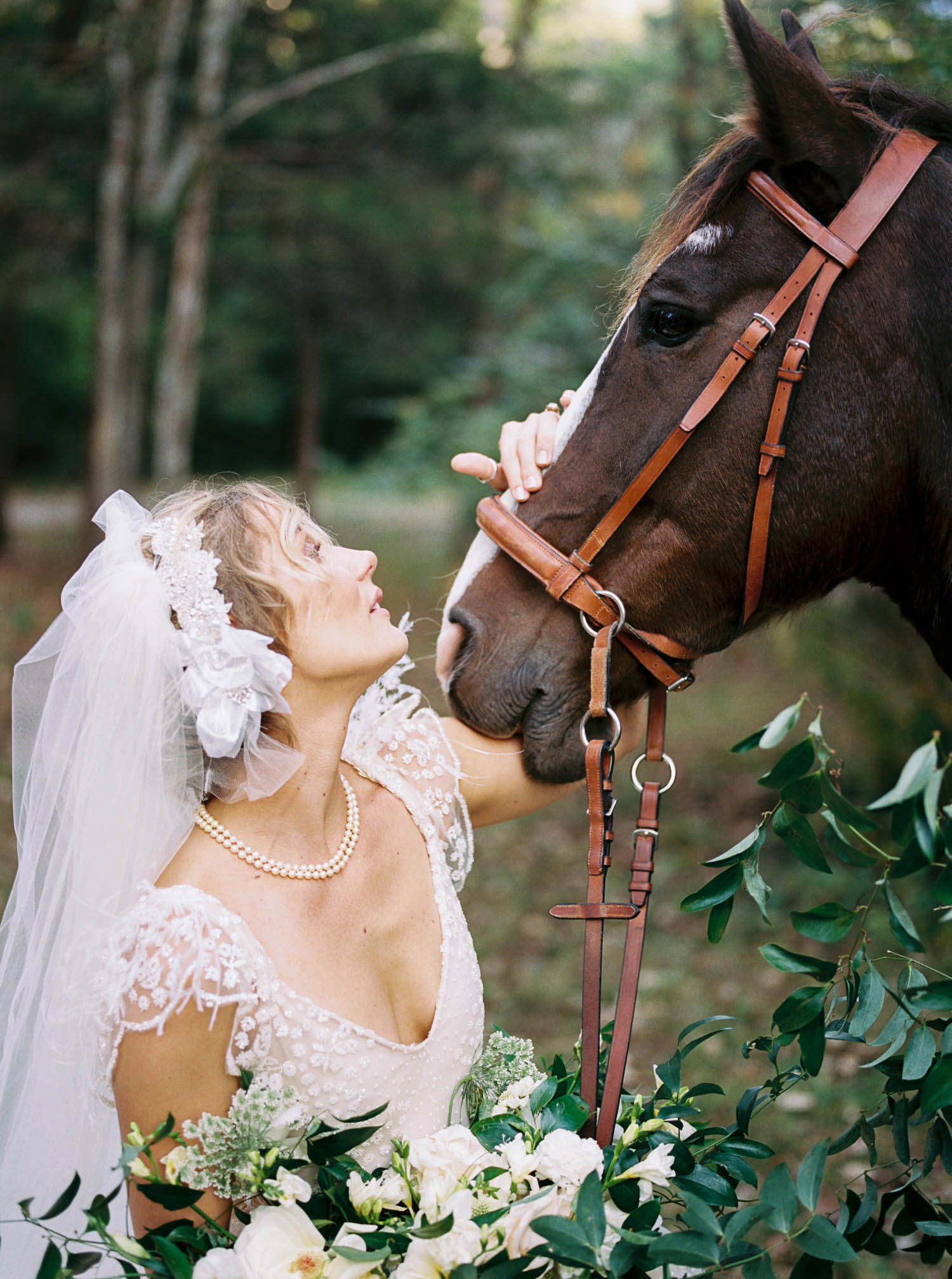 Lush bridal bouquet and floral garland for horse. Nashville Wedding Florist.