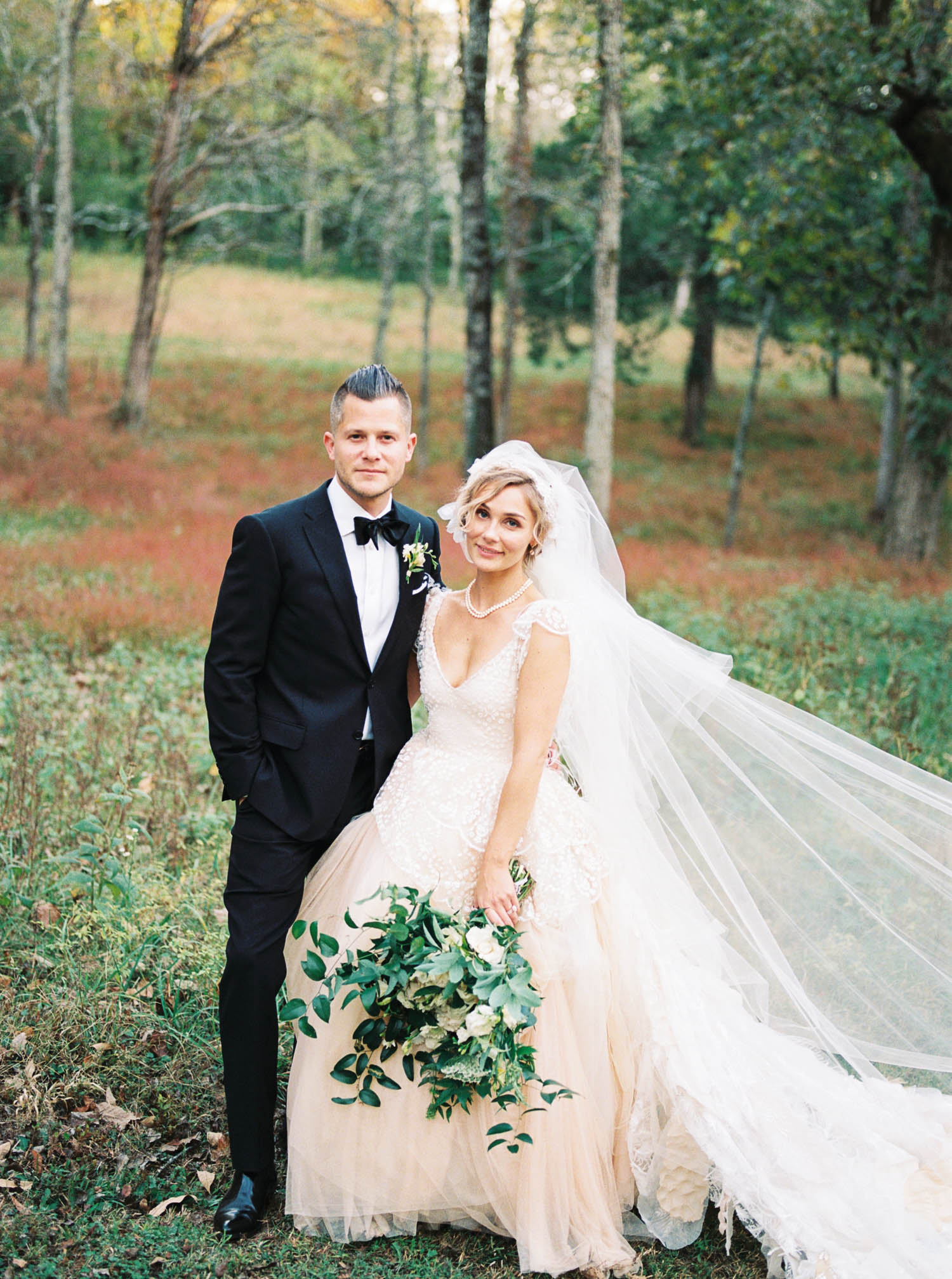 Blush wedding dress with asymmetrical, trailing floral design in Nashville, TN.