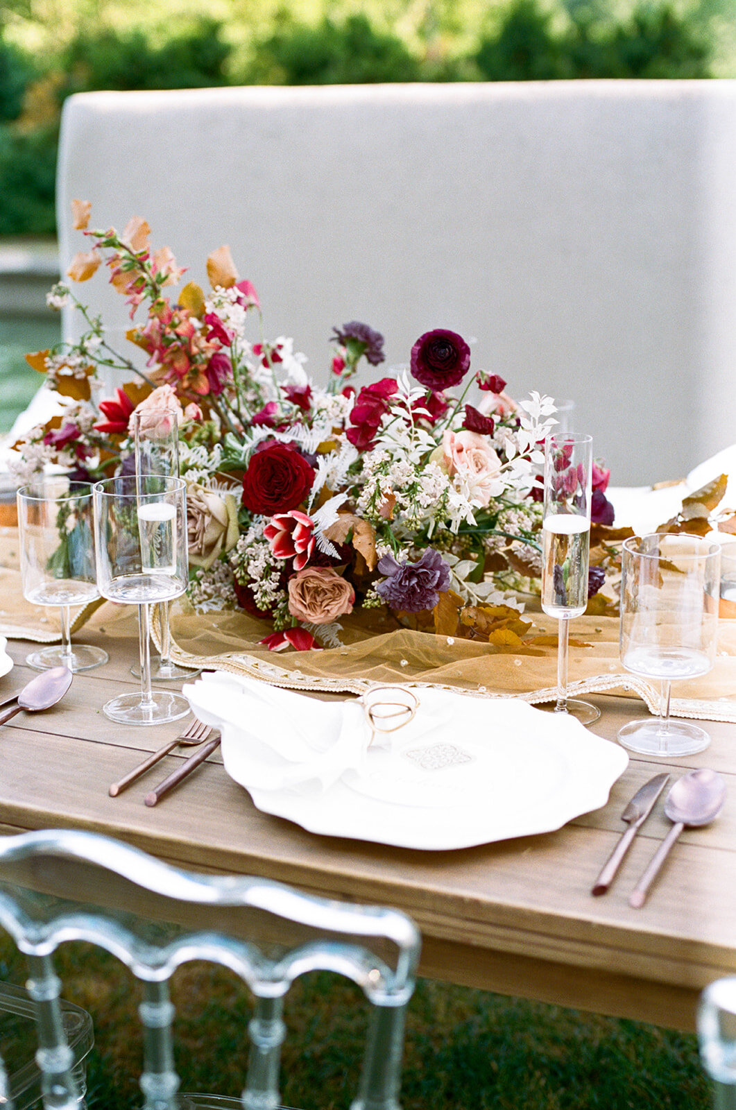 Low centerpiece with a mauve, rust, and burgundy color palette for an Indian wedding at Cheekwood Botanical Gardens. Nashville Wedding Florist.