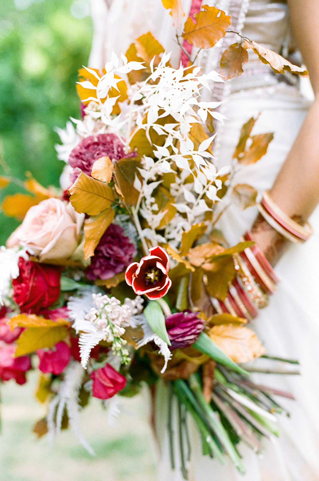 Copper, mauve, and marsala Indian bridal bouquet with white ferns, garden roses, sweet peas, and tulips. Nashville Wedding Floral Design.