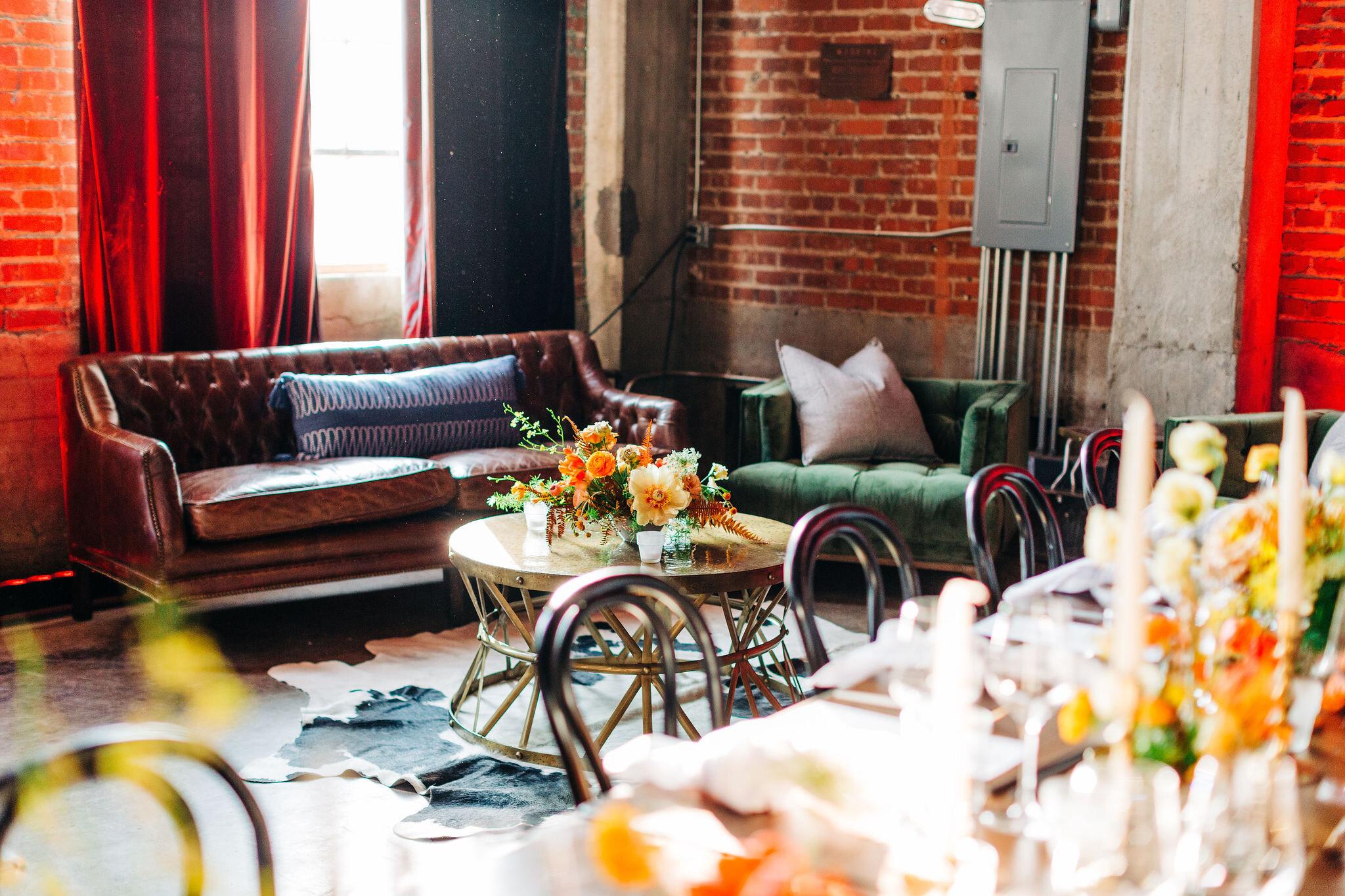 Rust orange, terra cotta, and golden yellow floral centerpieces for the CMT Songbird Supper Club 2019. Nashville event florist.