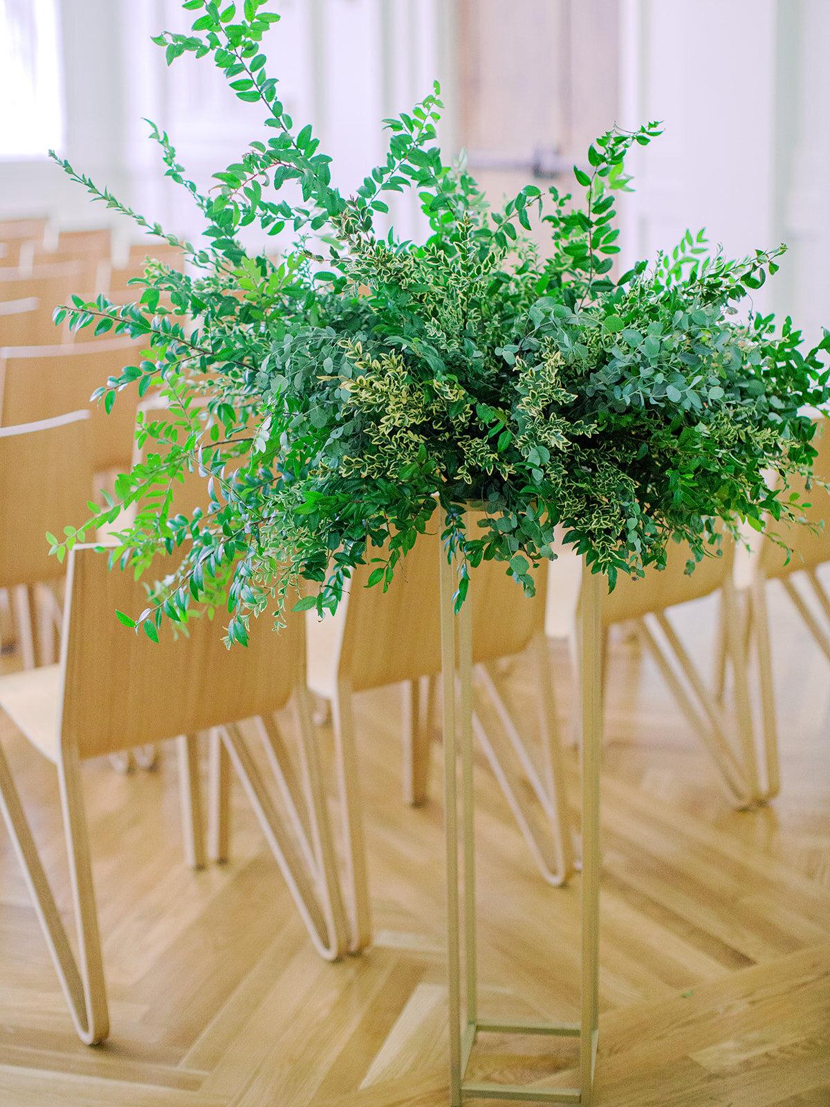 All greenery organic arrangement on a modern gold stand. Nashville wedding florist.