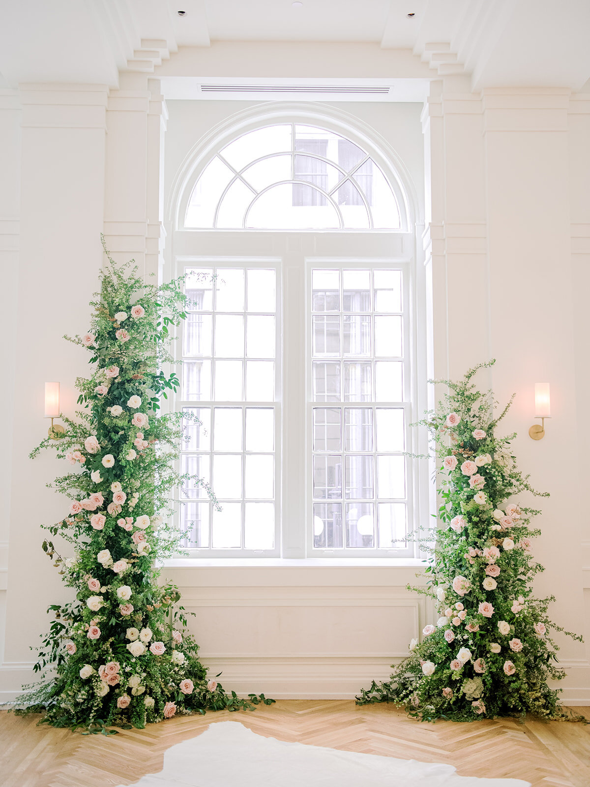 Asymmetrical floral installation growing up either side of the windows in the Noelle. Nashville Wedding Florist.