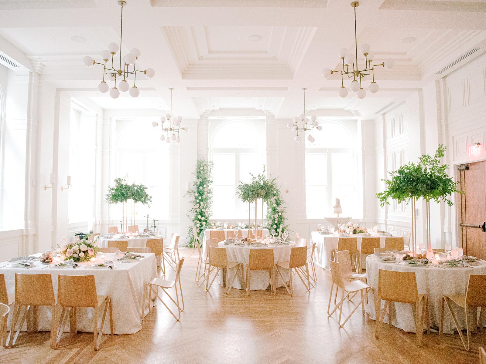 Blush garden roses, white ranunculus, and garden-inspired greenery. Organic wedding floral design at the Noelle in Nashville.