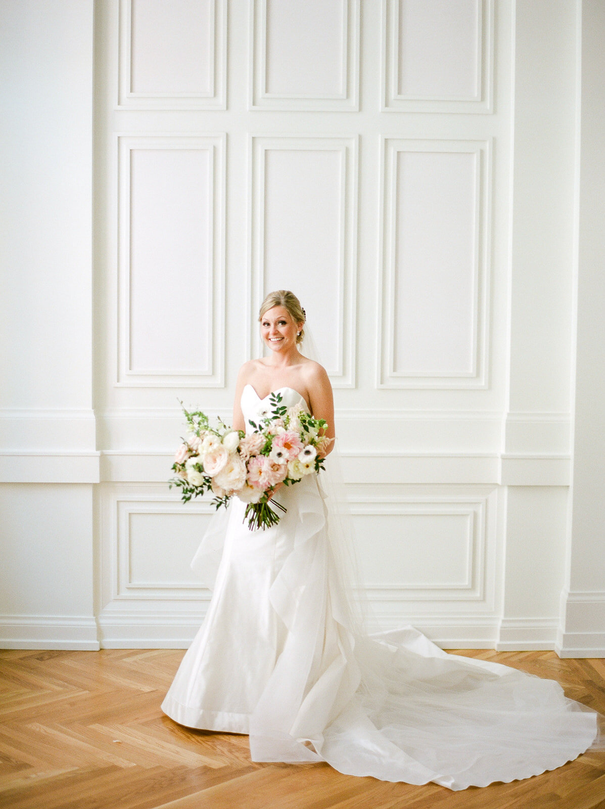 Blush, ivory, and greenery bridal bouquet with dahlias, garden roses, peonies, and anemones. Nashville wedding florist, Rosemary and Finch.