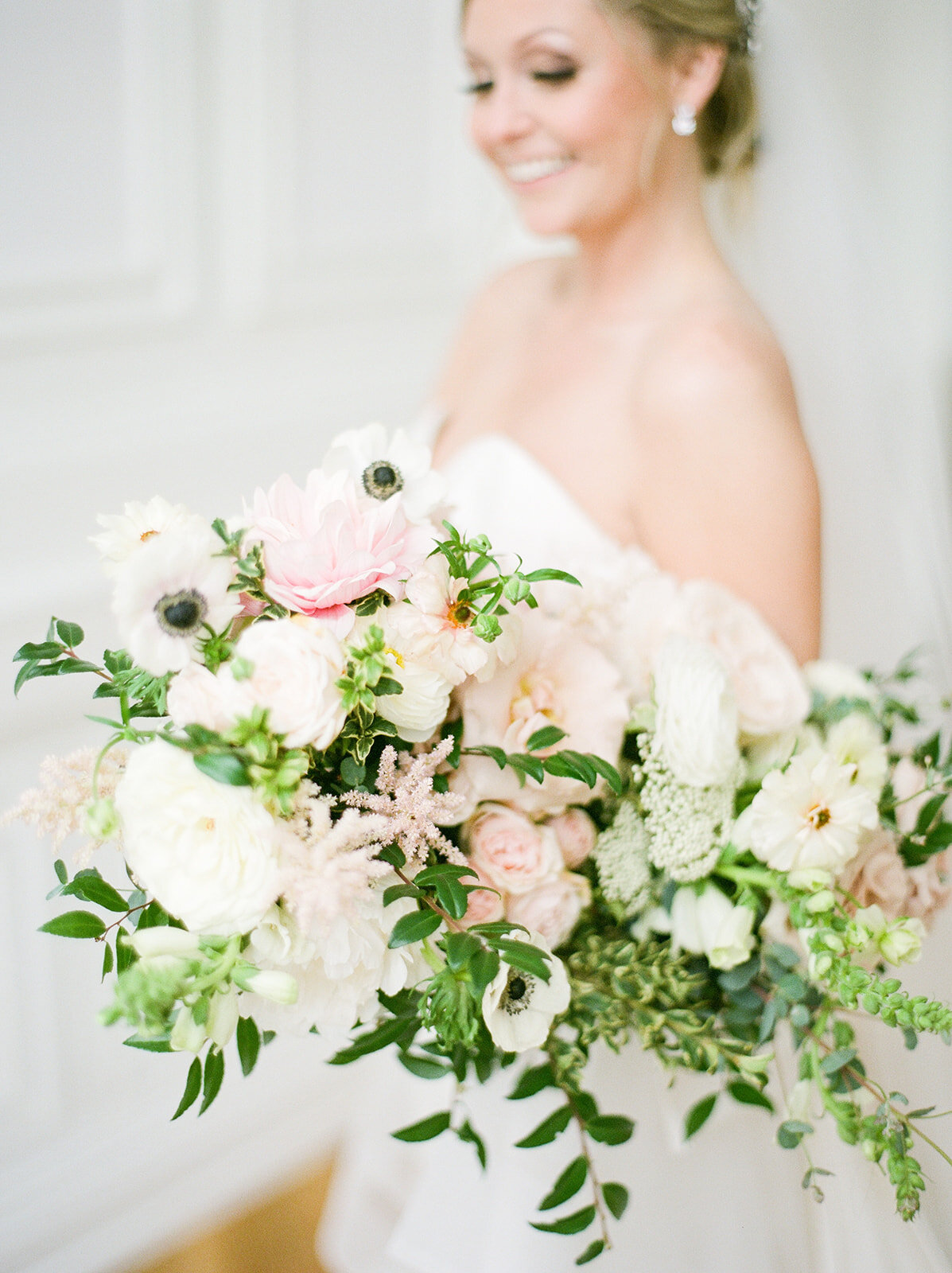 Garden-inspired bride's bouquet with blush and white color palette including lots of lush, untamed greenery. Nashville wedding floral designer, Rosemary and Finch.