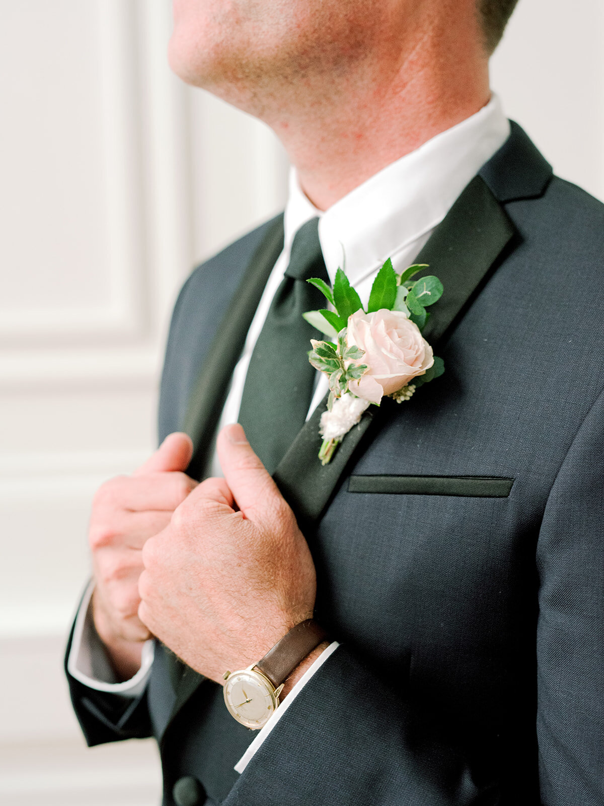 Blush and ivory groom's boutonniere with texture and natural greenery. Nashville wedding florist.