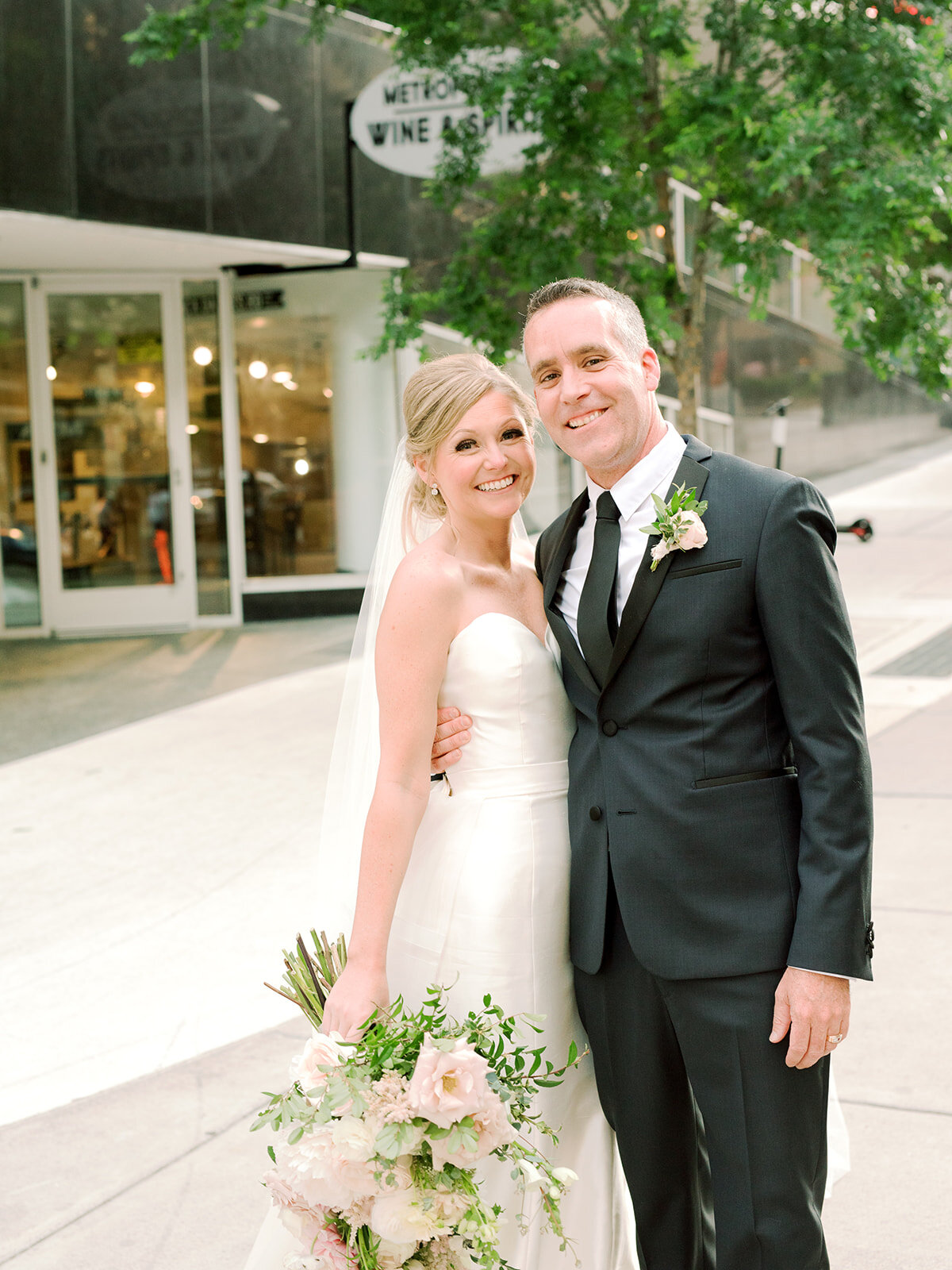 Downtown Nashville bride and groom portraits with blush and ivory color palette.