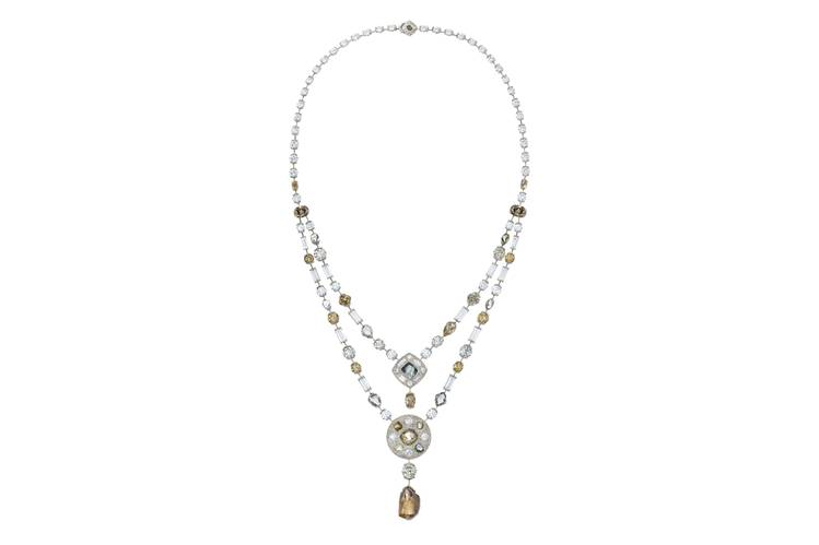 This gorgeousDe Beers necklace from theirTalisman collection has a 13 carat center pendant of orange rough diamond. The lengthwascreated using rough diamonds and baguettes along with cuts of polished diamonds on the medallions. The price? A whopping $550,000.     PHOTO:DE BEERS