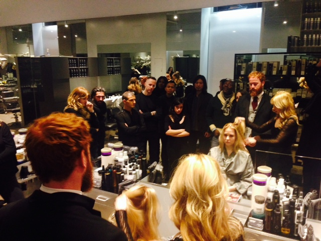 """Famed stylist Adam Livermore consults with Rachael on doing Oribe's """"Signature Cut"""" as the LAICALE team observes"""