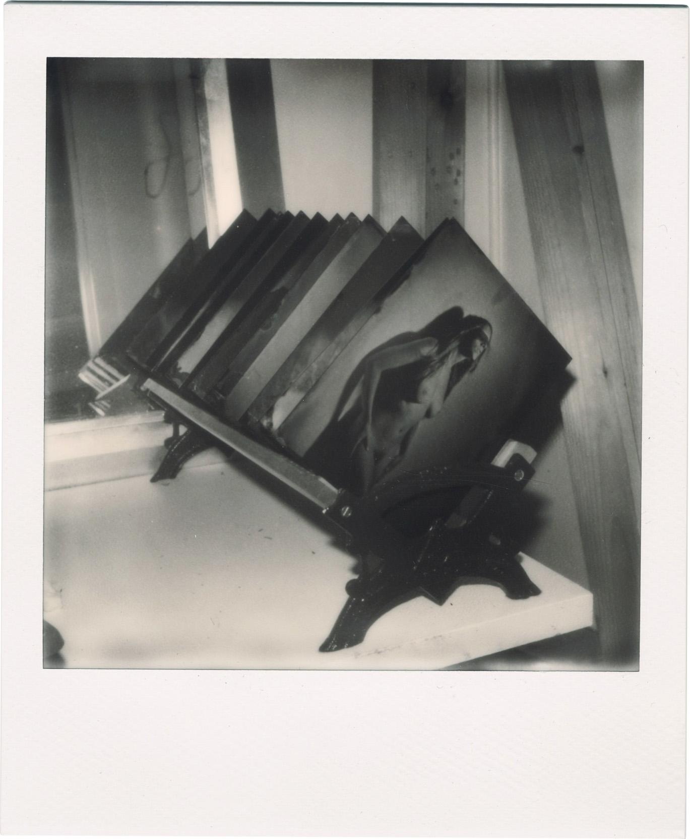 The plate rack. Black and white Polaroid.