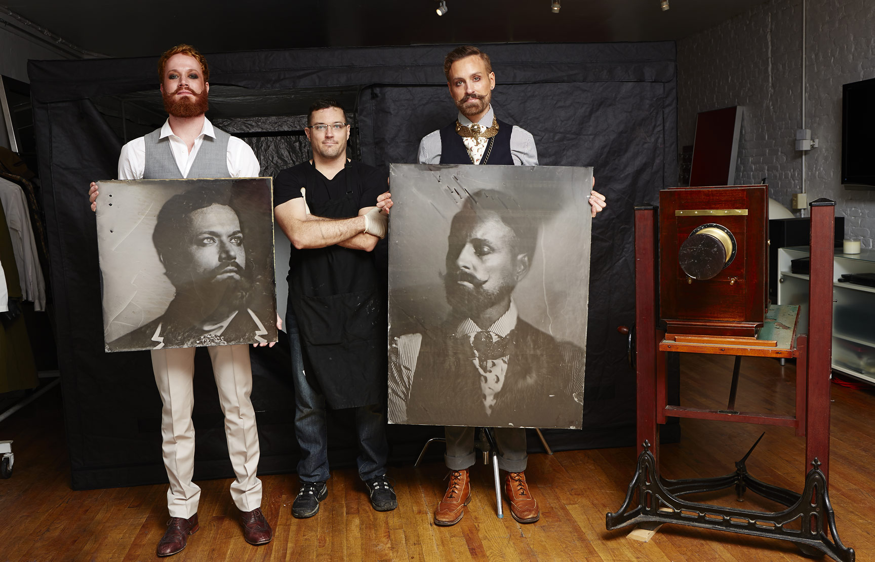 "Me standing next to my beautiful friends and subjects, Adam LIvermore and Jon Lieckfelt.  They are each holding their portraits.     (L):  Adam Livermore, 24""x24"" on Black Aluminum.  (R):  Jon Lieckfelt, 30""x40"" on Black Aluminum."