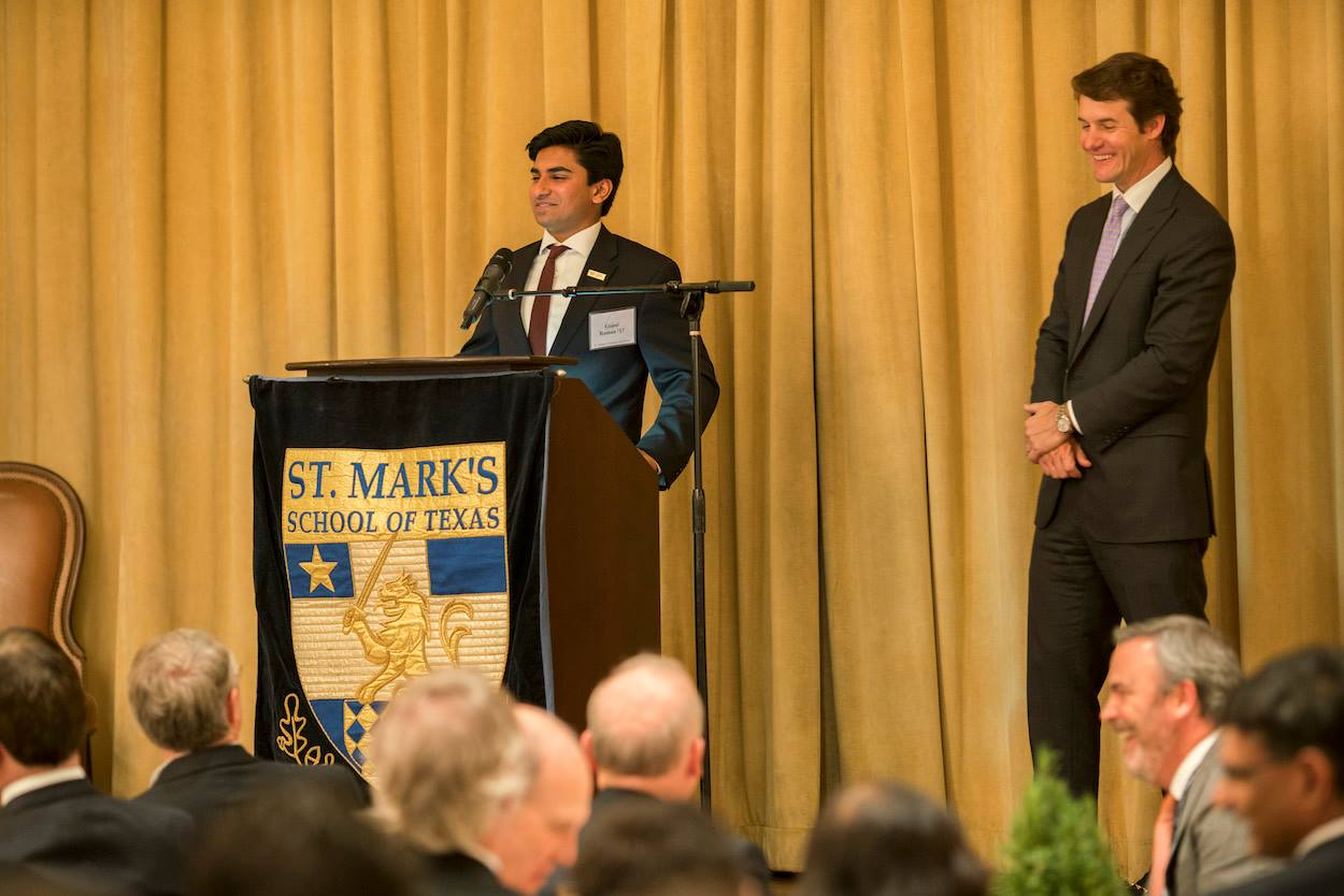 Answering questions from the audience after speech;standing beside is Alan Schoellkopf, President of the Alumni Board.