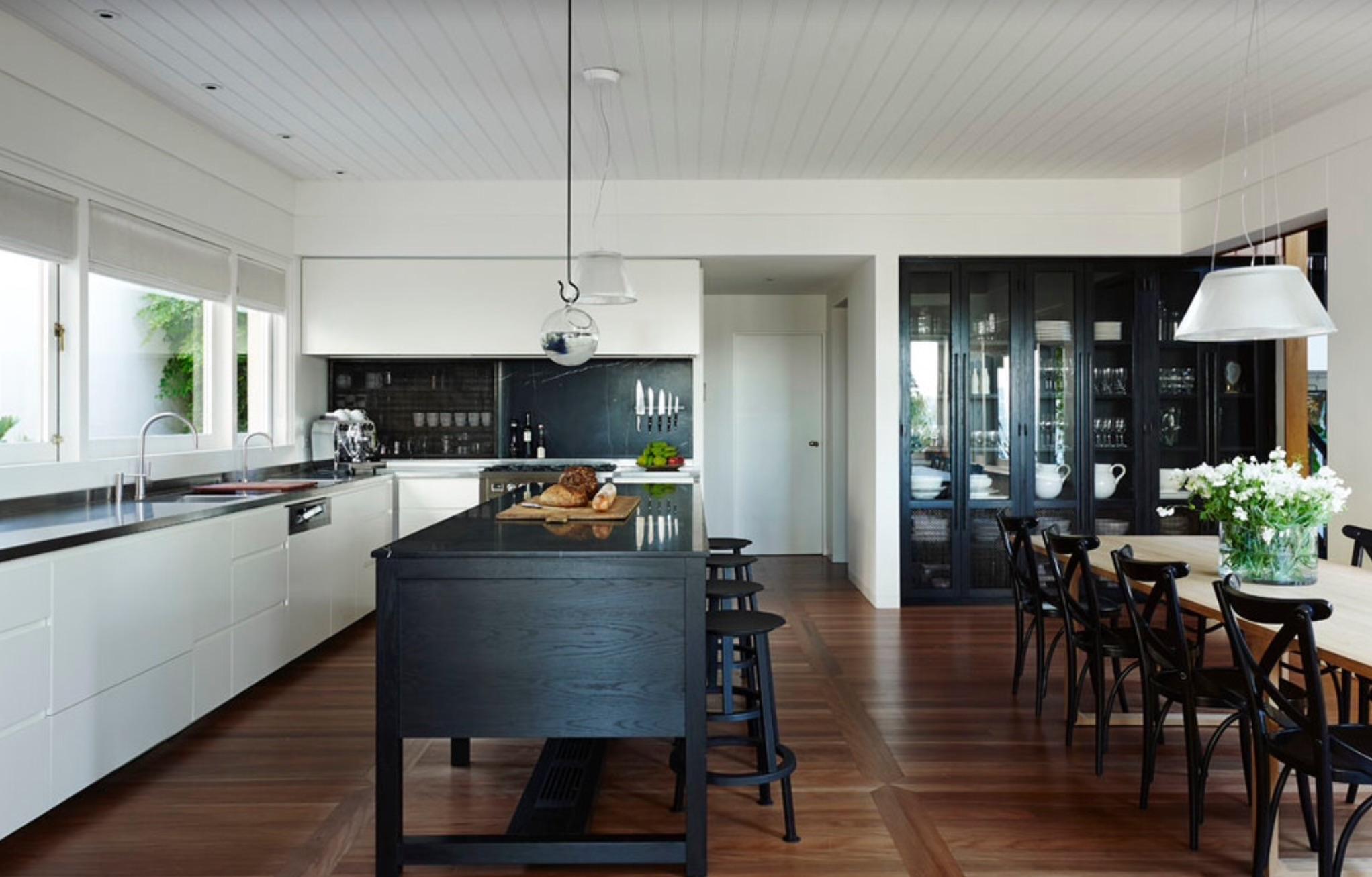 Black island and built-in china cabinet: Design by Sarah Davison Interior Design