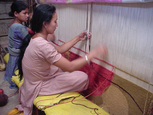 A hand-knotted rug on loom - keep in mind an 8x10 rug has somewhere near 2 million individually hand tied knots