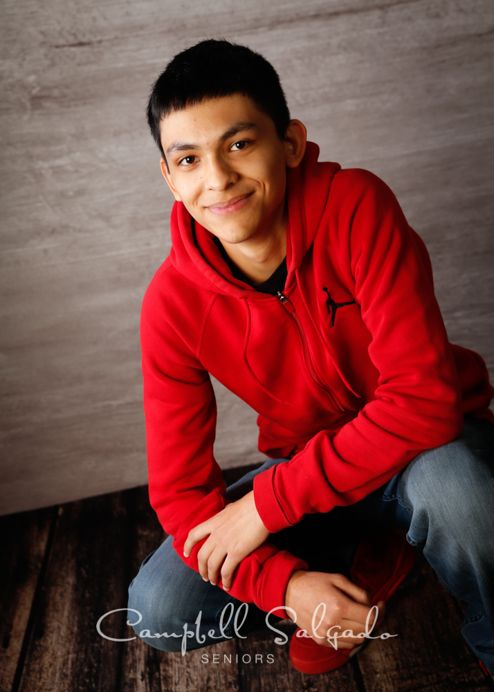 Senior picture of a young man on graphite background by high school senior portrait photographer at Campbell Salgado Studio in Portland, Oregon.