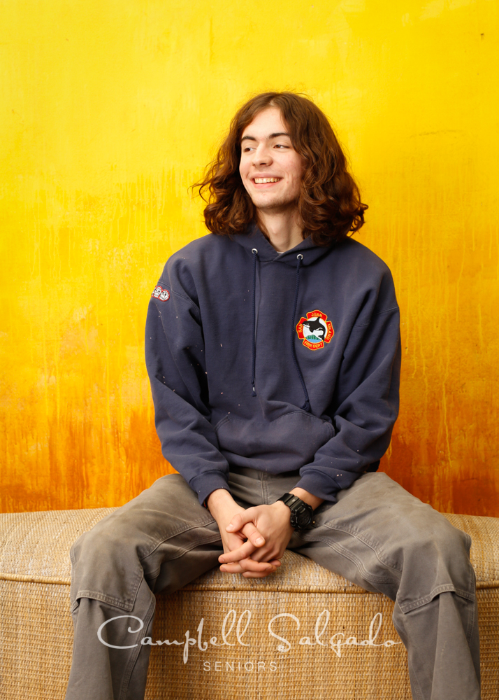 Senior pictures outside of a young man in front of a liquid sunshine background by high school senior portrait photographers photographers at Campbell Salgado Studio in Portland, Oregon.