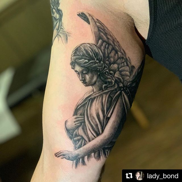 Tattoo by Lady Bond @lady_bond • #Repost @lady_bond with @get_repost ・・・ Sneak peek at a new project. A very heartfelt sleeve in the making. I'm honored to be a part of the process. Thank you @leviwinfrey for trusting me to be your artist. * * * #angel #angeltattoo #love #loss #family #familytattoo #mother #motherandson #staytrue #courage #strength #blackandgrey #sleeve #workinprogress #storm #brave #bondtattoosociety #templeoftattoo