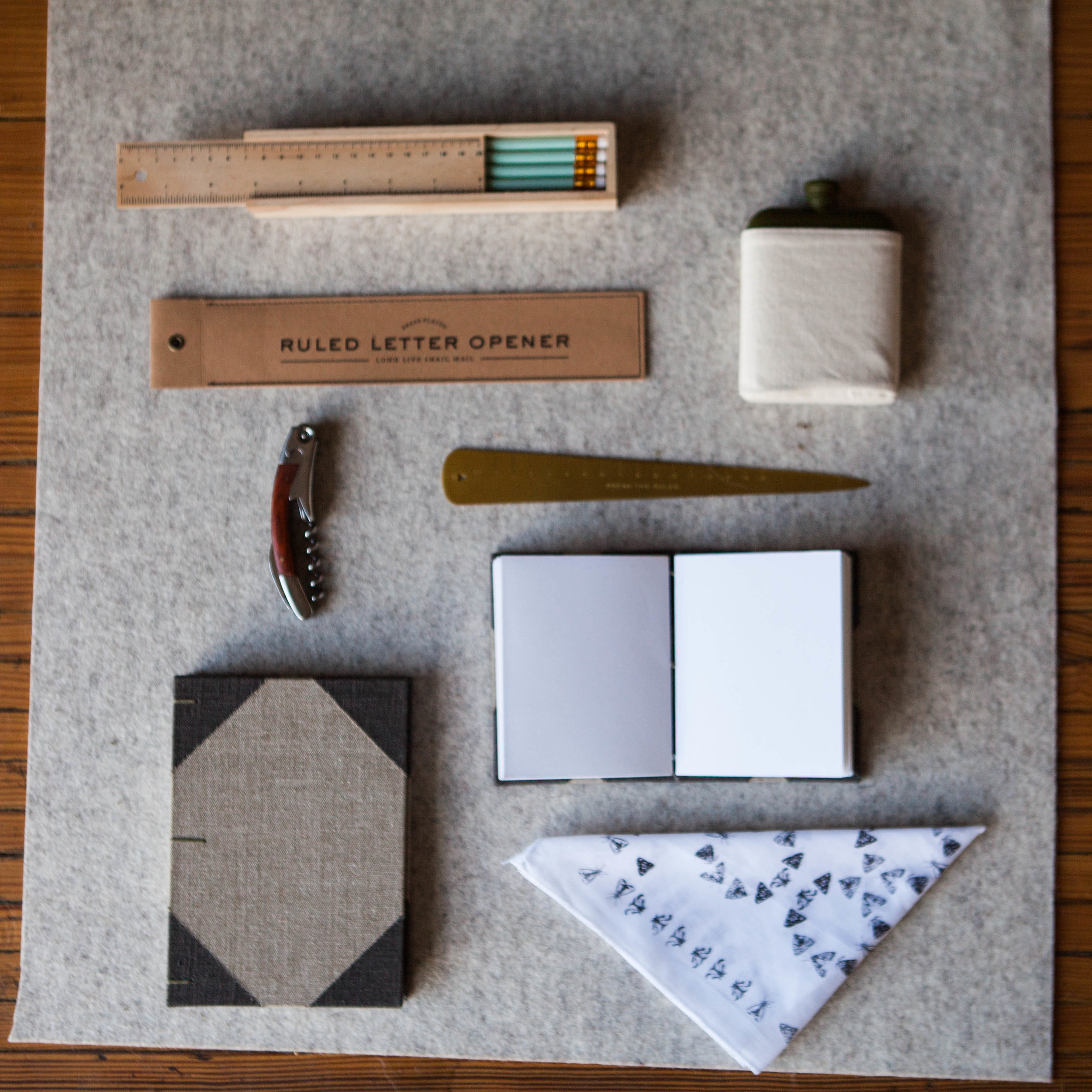 Pencil and Ruler Box Set $15, Ruled Letter Opener, $19, Bottle Opener $18, Handmade Linen Notebooks, $30-44, Handprinted Catherine Willett Handkerchief $11
