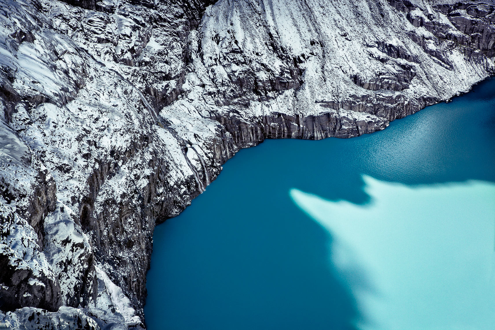 "One of Milford's glacial lakes, formed by erosion and melting of ice at the glacier's base. The vibrant blue is the result of light reflecting off tiny pieces of rock, ""rock flour"", that become suspended in the water as the glacier melts."