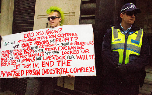 'Good point, well made', thinks nice policeman. 'Cops are tops', thinks protester.  Pro-Refugee Protest  by Tali Caspi/ cc