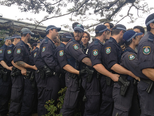 Riot squad having a whale of a time with their freedom of assembly rights.  Police Conga Line  by Jason Marshall/ cc