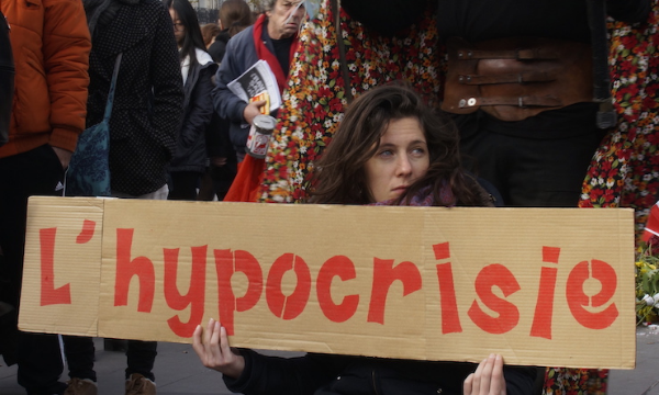 A climate protester in Paris. (Image: Thom Mitchell)