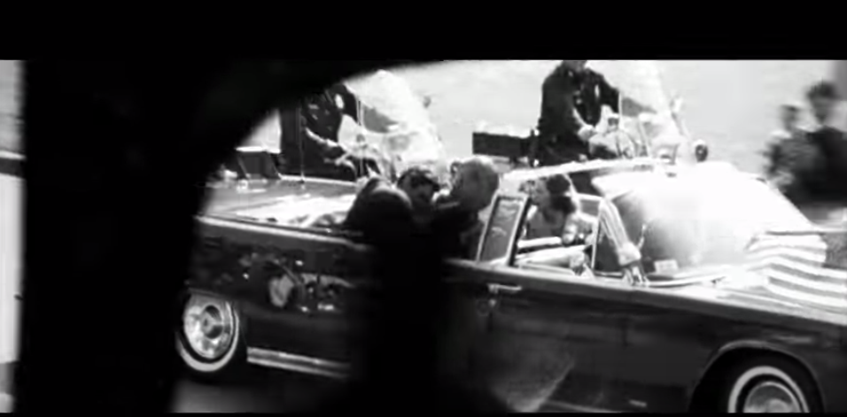 If you look closely you can see JFK giving Oswald a nasty punch to the face.