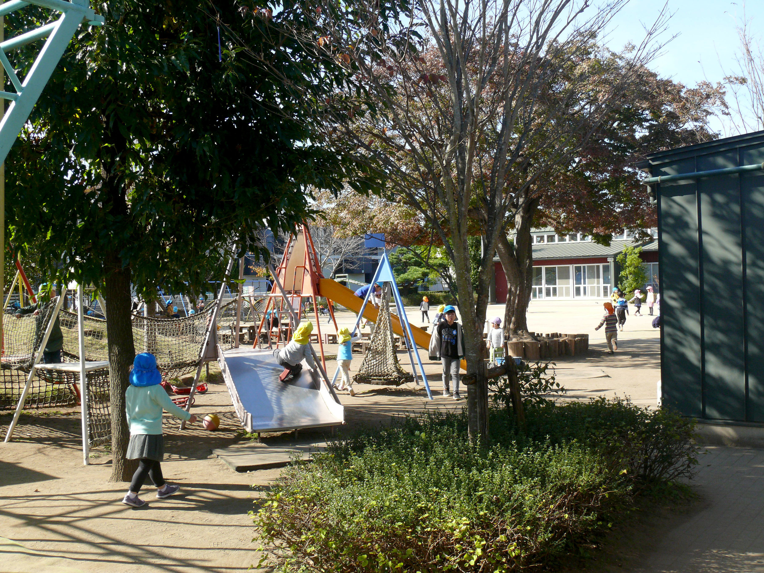"At this preschool / Kindergarten in Japan children have many options during recess including quiet spaces, climbing for heights, a ""yard"" for ball play, and places to look for insects."