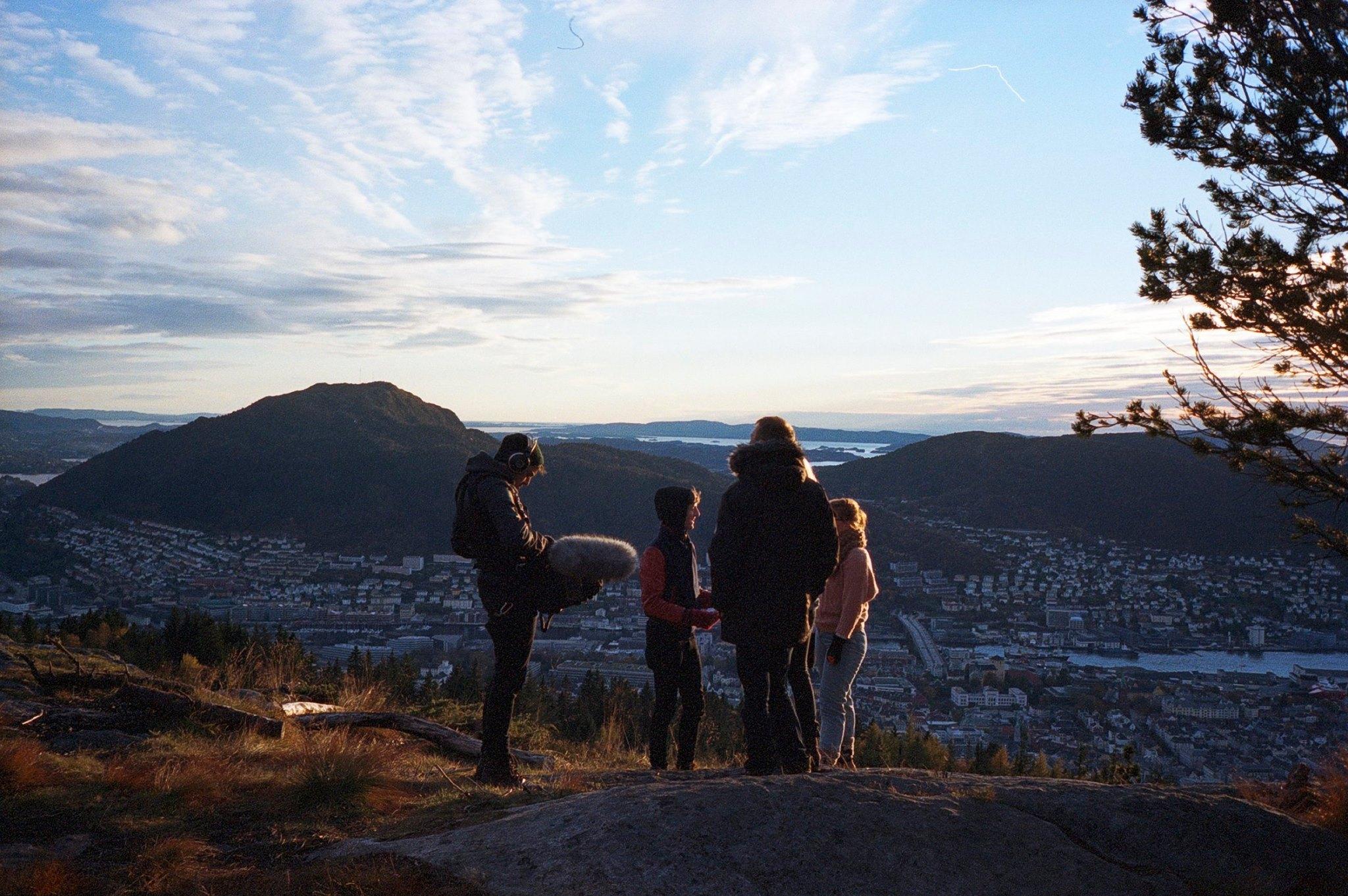 Team talking out a scene in Bergen, Norway