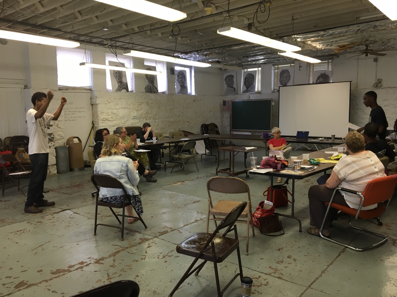 *Image of a collaborative writing workshop held in the Service Employees International Union with ShowMe15 organizers as participants. This is one of several break out writing sessions for the Bread & Roses Missouri Worker's Opera. Organizer Joan Suarez, Theatre Maestro Agnes Wilcox, and Labor Historian Rosemary Feurer onlook.