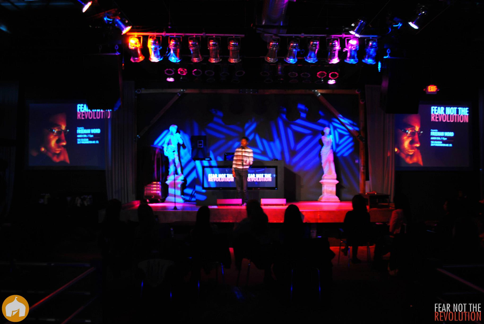 *Image of my performance/stage setup for Fear Not The Revolution - over 100 people attended to hear poetry on a Wednesday night at the Coliseum. In lieu of a senior thesis, I decided to produce, promote, and headline my own poetry show. Community activists Zaki Baruti, Melvin White, and Olajuwon Ali gave speeches. Artists Aimee Le, Gerald Jackson, Loren D, and Louis Conphliction performed.