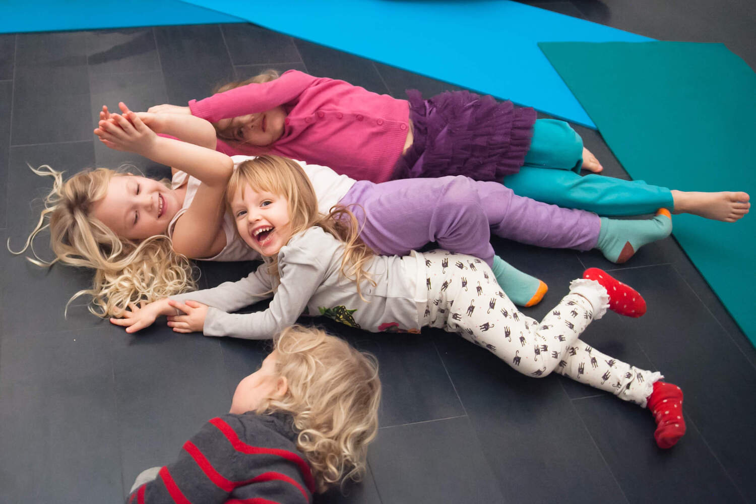Children playing and laughing on the floor