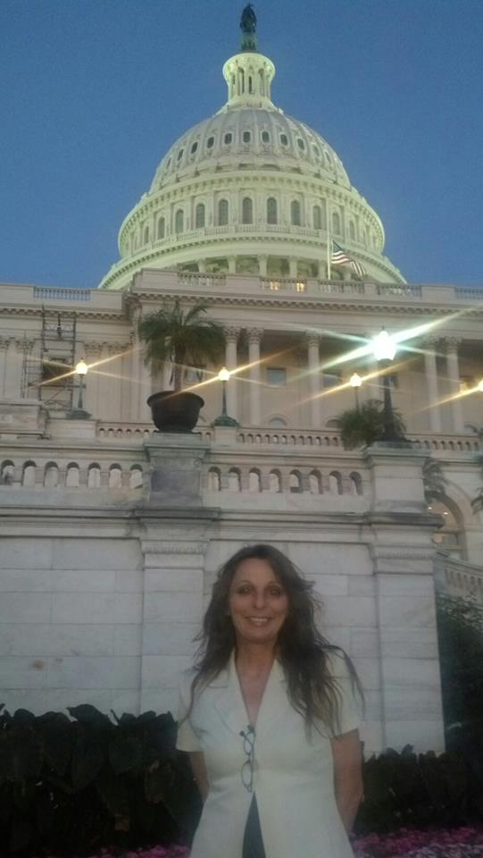 Pam at the Capital Building in Washington DC after conducting an outreach to U.S. senators for the ReThink911 campaign and AE911Truth