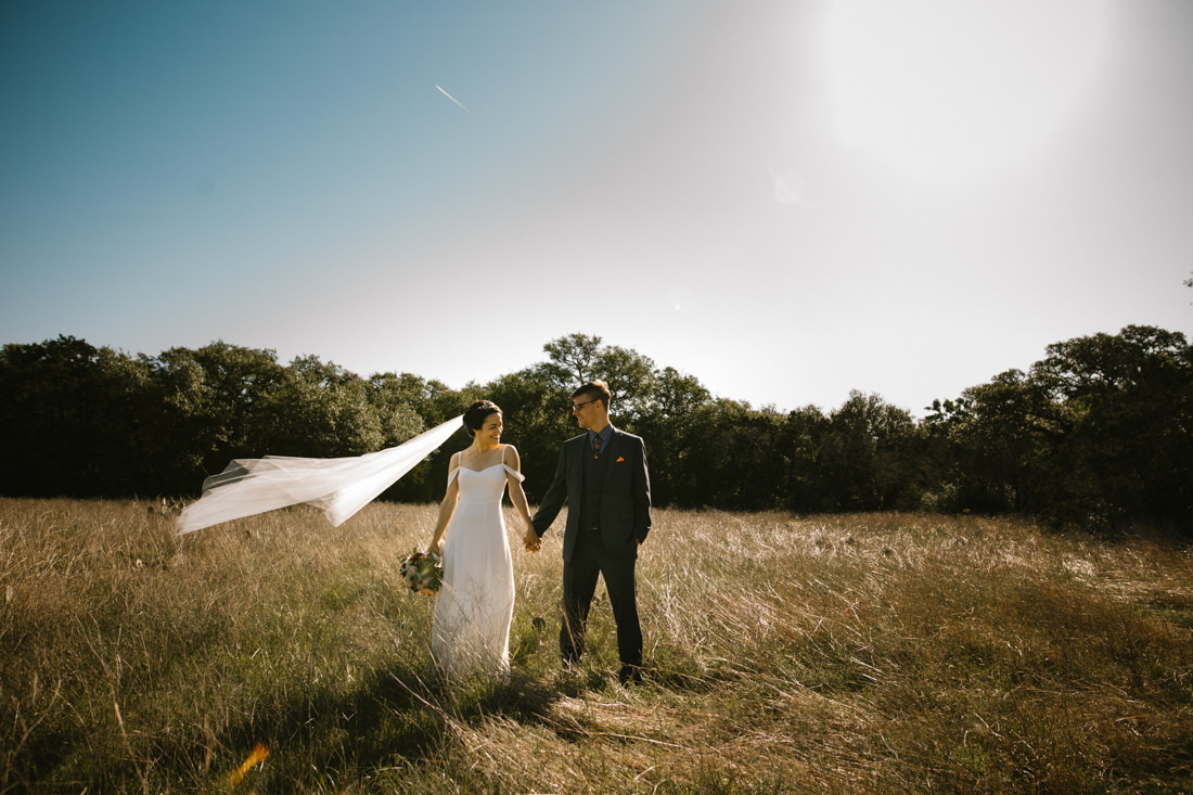 Bride and Groom in noon light in Austin forest