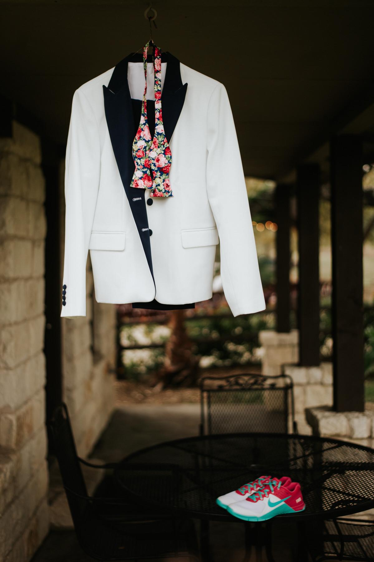 Same sex bride's suit at Ranch Austin wedding